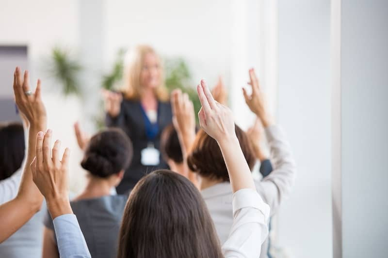 Group of women voting during seminar-cm