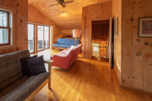 Futon sofas and doors to balcony in the master bedroom