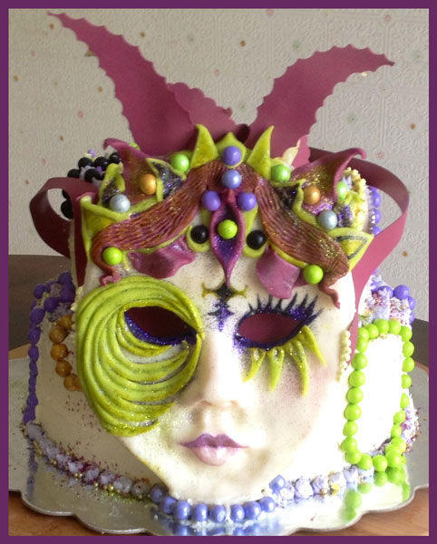 Mardi Gras cake decorated in modeling chocolate