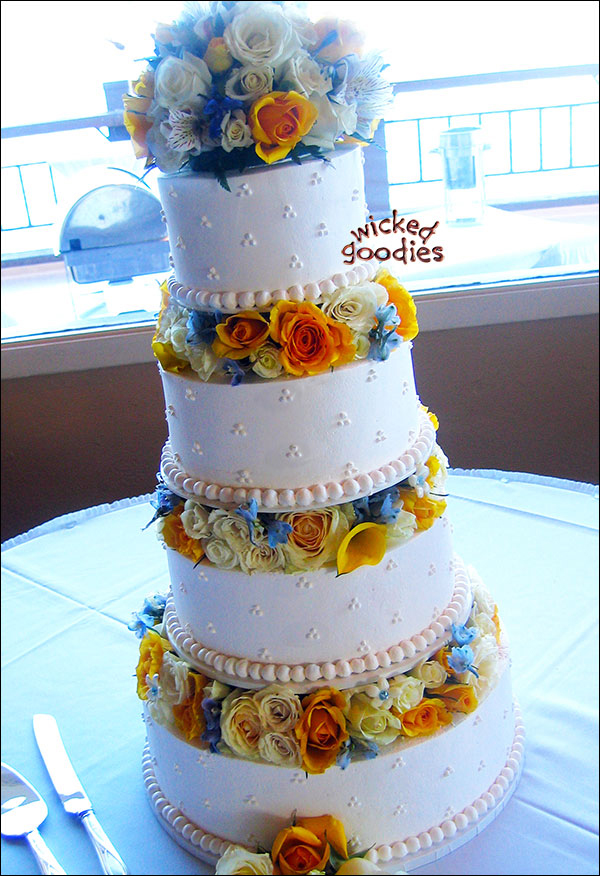 Classic White Wedding Cake with Raised Tiers and Fresh Flowers