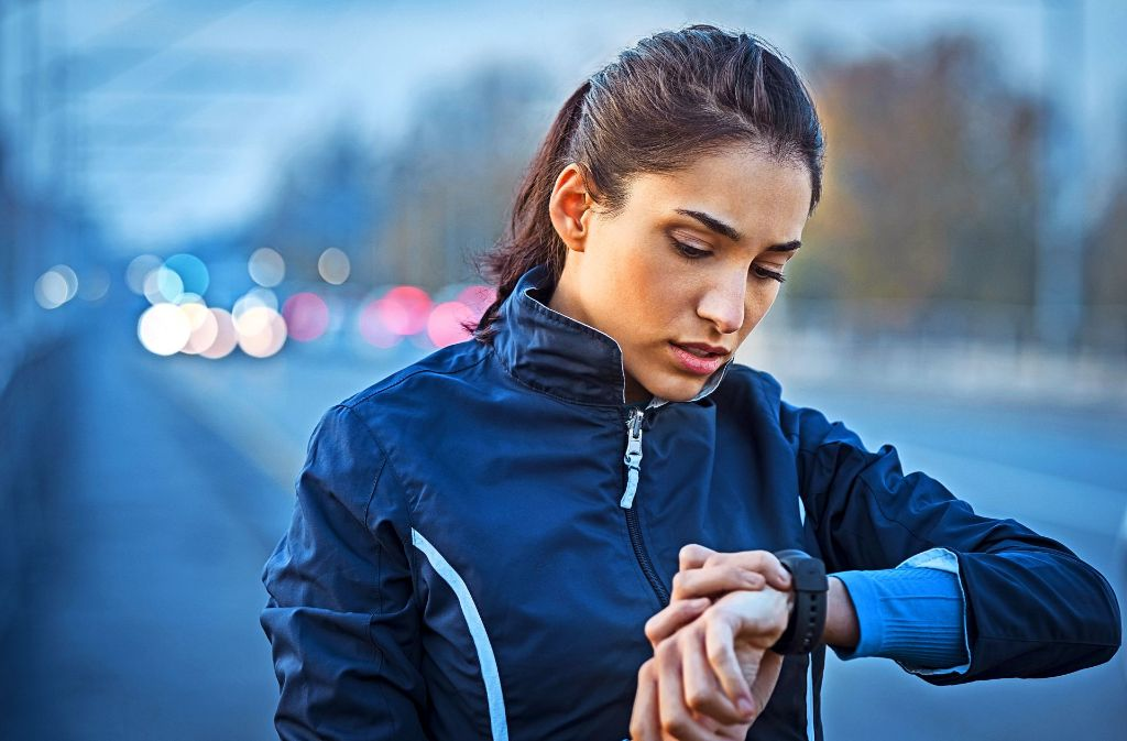 fit woman checking her watch