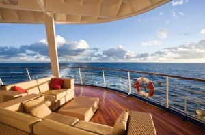 The Aft Lounge on the 700-passenger luxury ship, Seven Seas Mariner   Small Luxury Ship Charters by Landry & Kling