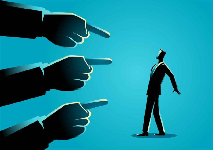illustration of a businessman being at pointed by three giant fingers