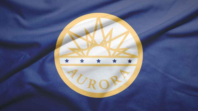 Gold Aurora, Colorado city seal on blue fabric background