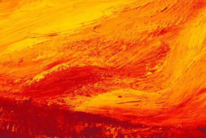 Abstract art canvas background with brush texture and red, orange and yellow colors.