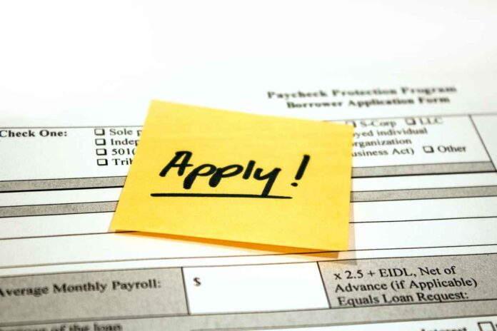 An application for the Paycheck Protection Program with a reminder note saying