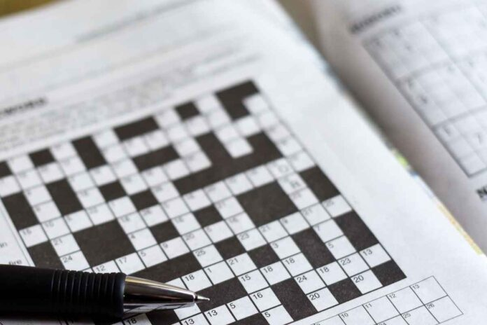 Close up of crossword puzzle and pen