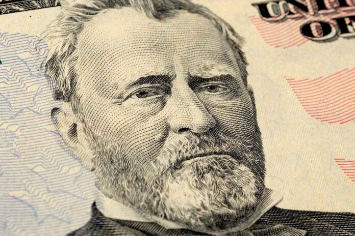 Close up of engraving of bearded Ulysses S. Grant on US $50 bill.