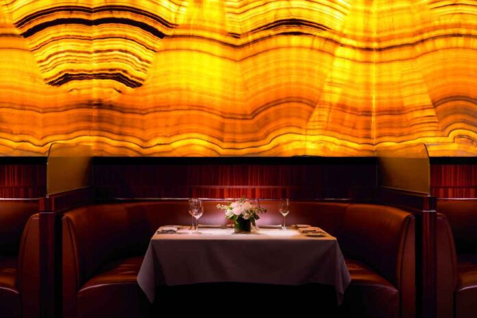 Restaurant booth with golden wallpaper and lighting background.