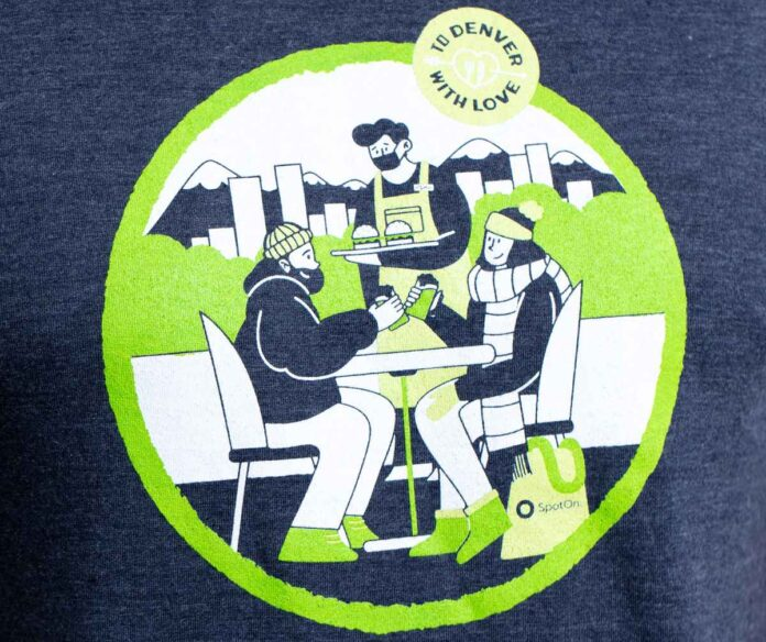 Illustration in lime green, navy blue, and white of two people dressed in winter gear eating outside at a restaurant.