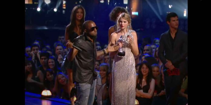 Kanye West stealing microphone from Taylor Swift at 2009 VMA Awards.