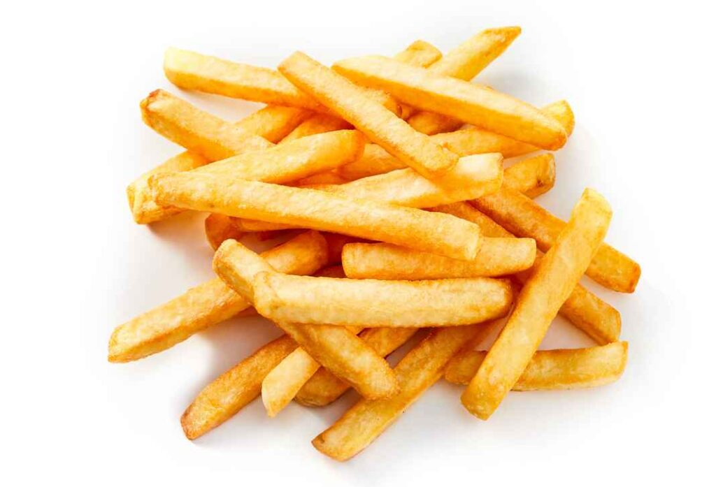 Heap of golden French fries on white background.