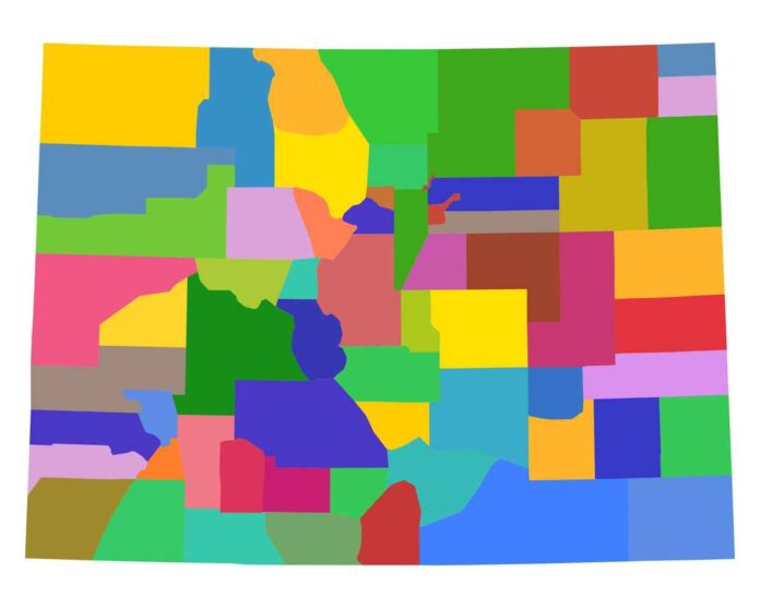 Map of Colorado with counties in varying shades of red, pink, green, blue, yellow, orange, and brown.