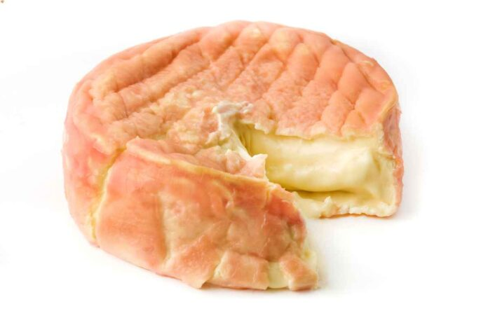 Soft, oozy wheel of white cheese with pink rind.