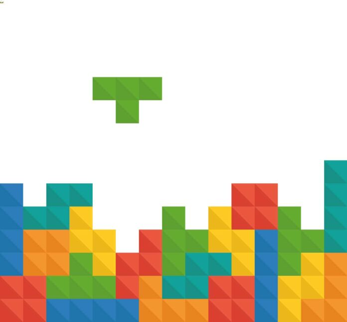 Screenshot of Tetris game, trying to fit different shaped blocks of blue, orange, yellow, red, and green together.