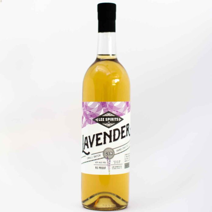 Bottle of deep yellow liqueur with purple and white label reading