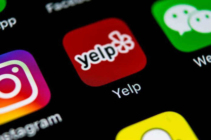 Close up of Yelp app icon on smartphone screen