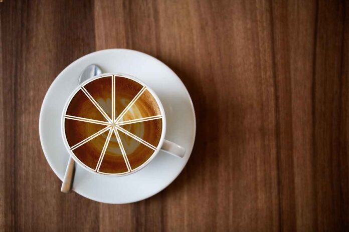 Overhead view of white coffee cup and saucer on top of a brown table. Graphic of circle divided into eight wedges overlaying coffee cup symbolizing a share of the whole.