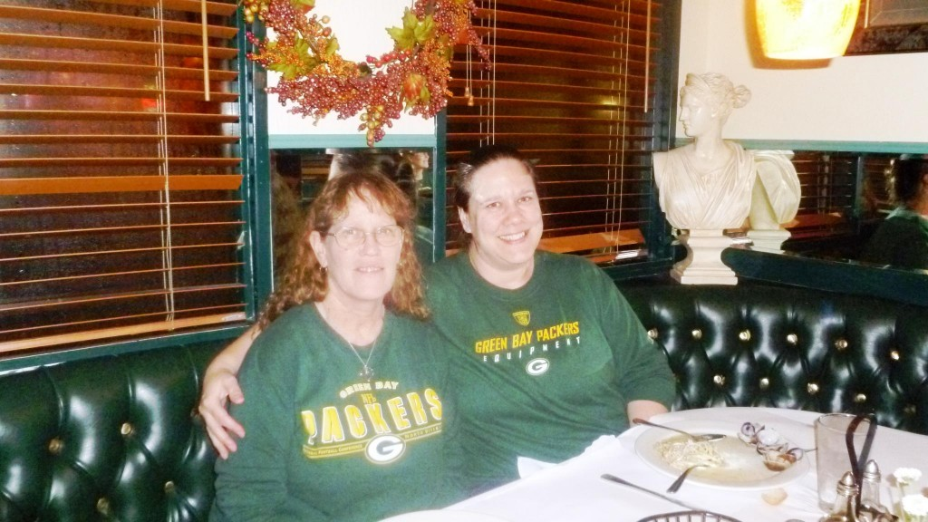 Packer fans enjoy a pre-game dinner at Buon Gusto's on Grand Avenue