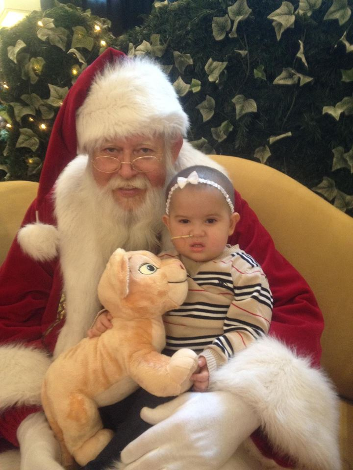 South City's Princess Warrior, Juliana Pena pictured here with Santa in 2011. Sadly childhood cancer took her life a few short months later.  Photo; J Pena