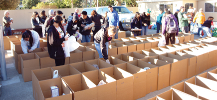 High school students and service group members prepared 400 boxes of food and toys in South San Francisco Dec. 14.  Photo: SF Catholic Online