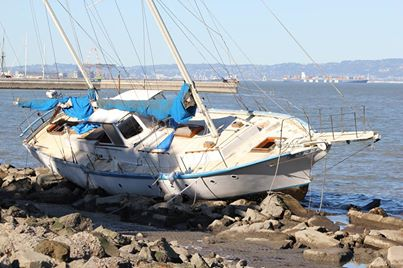Sailboat on the rocks at Oyster Point after the gusty Tuesday winds Photo: Joe Frezza