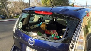 'Smash & grab' vehicle breaks have been reported on Mission Road by neighbors. Photo: Christa Barnett Haas' car was