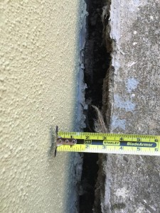 Ornellas started measuring the cracks between his home and the walkway