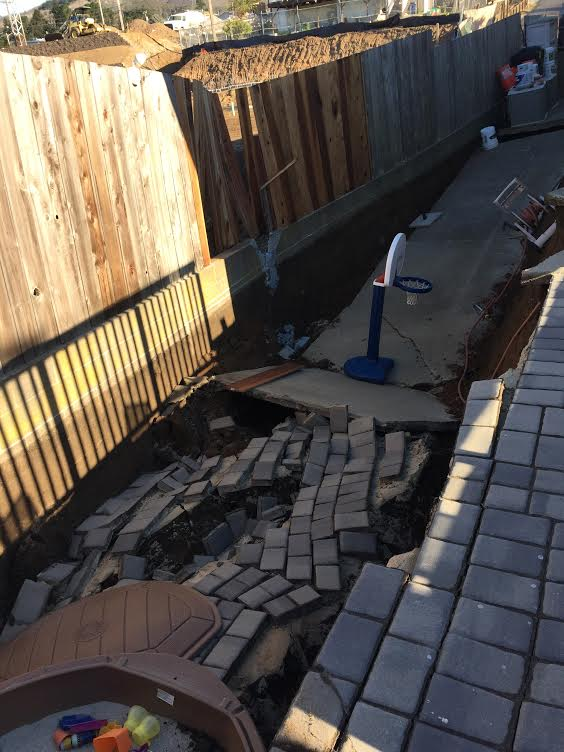 The 10 foot deep sink hole happened in the area the grandkids play daily. Photo: Adam Ornellas