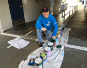 Dr Skerry serving our community at Los Cerritos Elementary School, painting messages for our students.