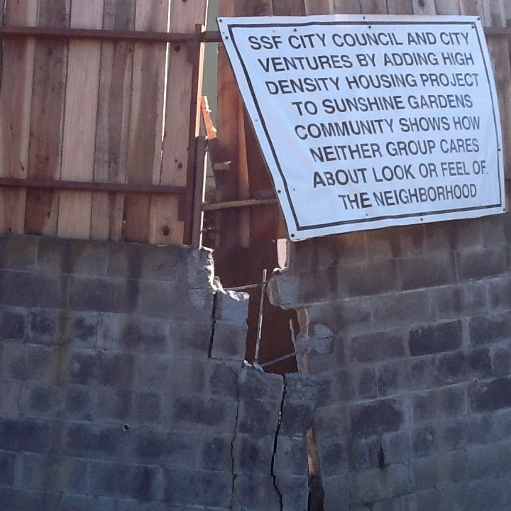 This sign echoes neighbor concerns as the retaining wall eventually collapsed.