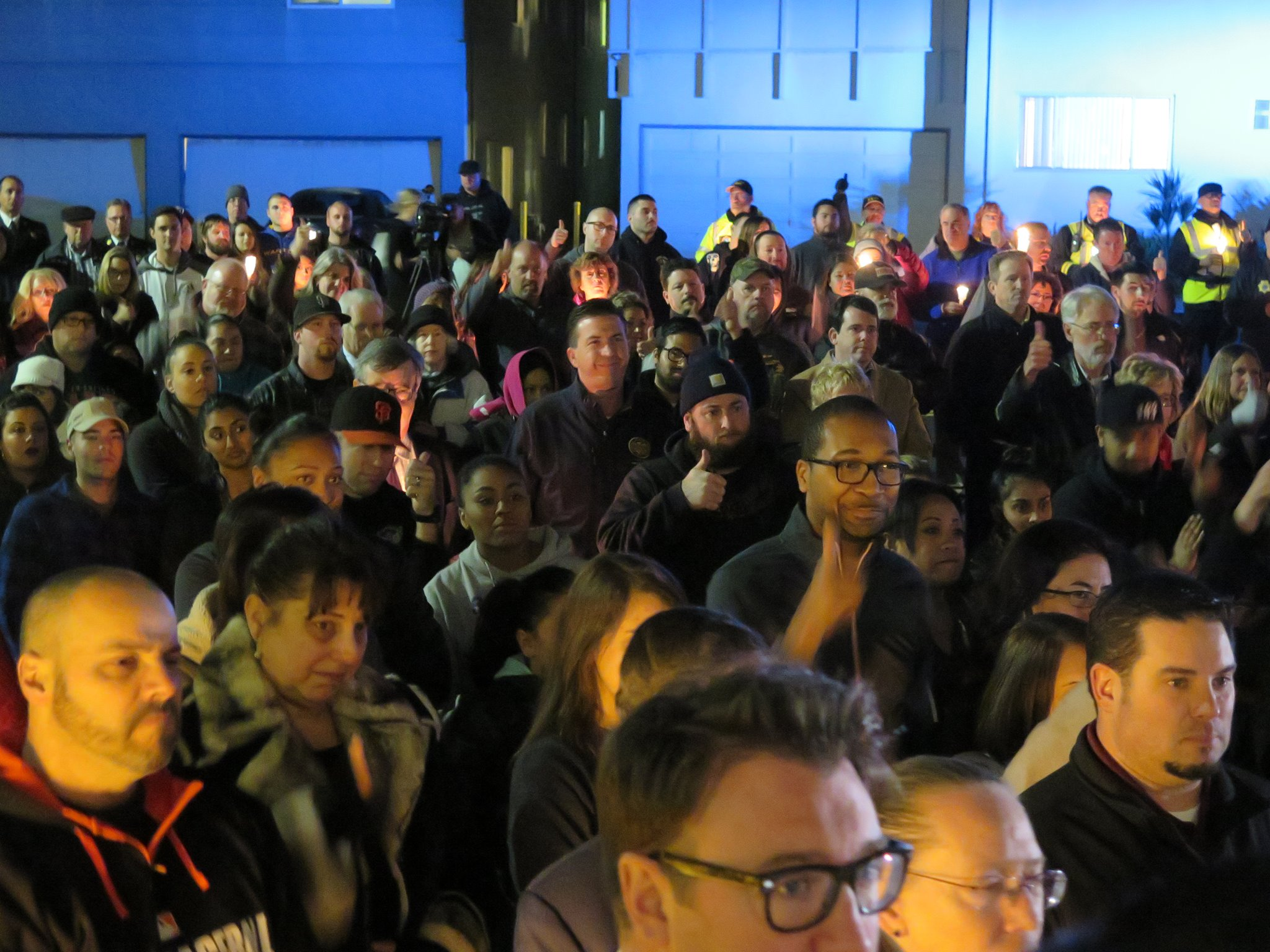 esc-vigil-crowd-3-thumbup