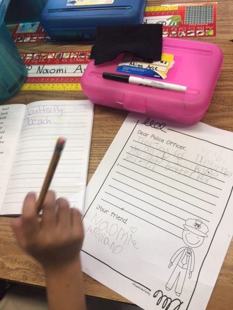 1st Grade letter and Ms. Arce's room pic = 1st graders in action writing their letters to Officer Chon, they are also using their dictionaries where they add academic words that they learn throughout the year as a resourcePhoto: Jonathan Covacha, Principal Martin Elementary School
