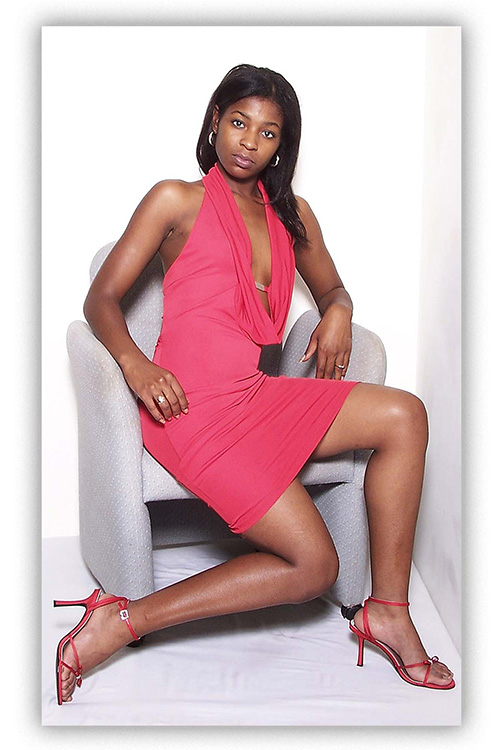 woman-in-hot-pink-dress-in-grey-chair