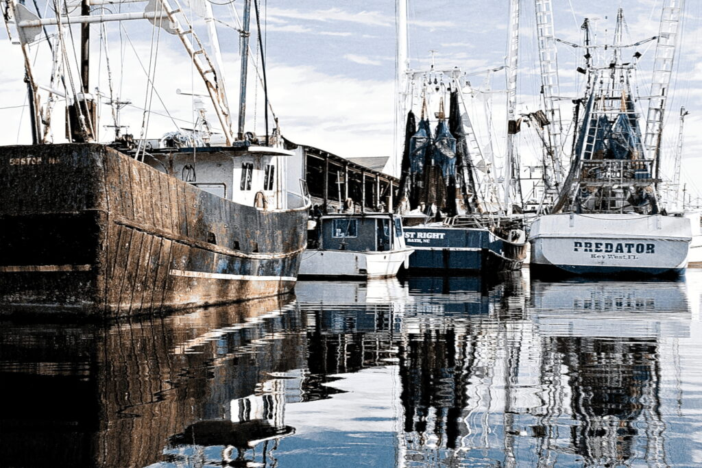 A lay day for commercial purse seiners alongside the wharf at Swan Quarter, North Carolina, a fishing village on the shore of Pamlico Sound.