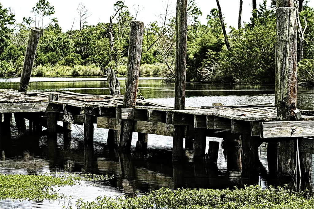 A splintered dock on the narrow channel of Bayboro, NC.