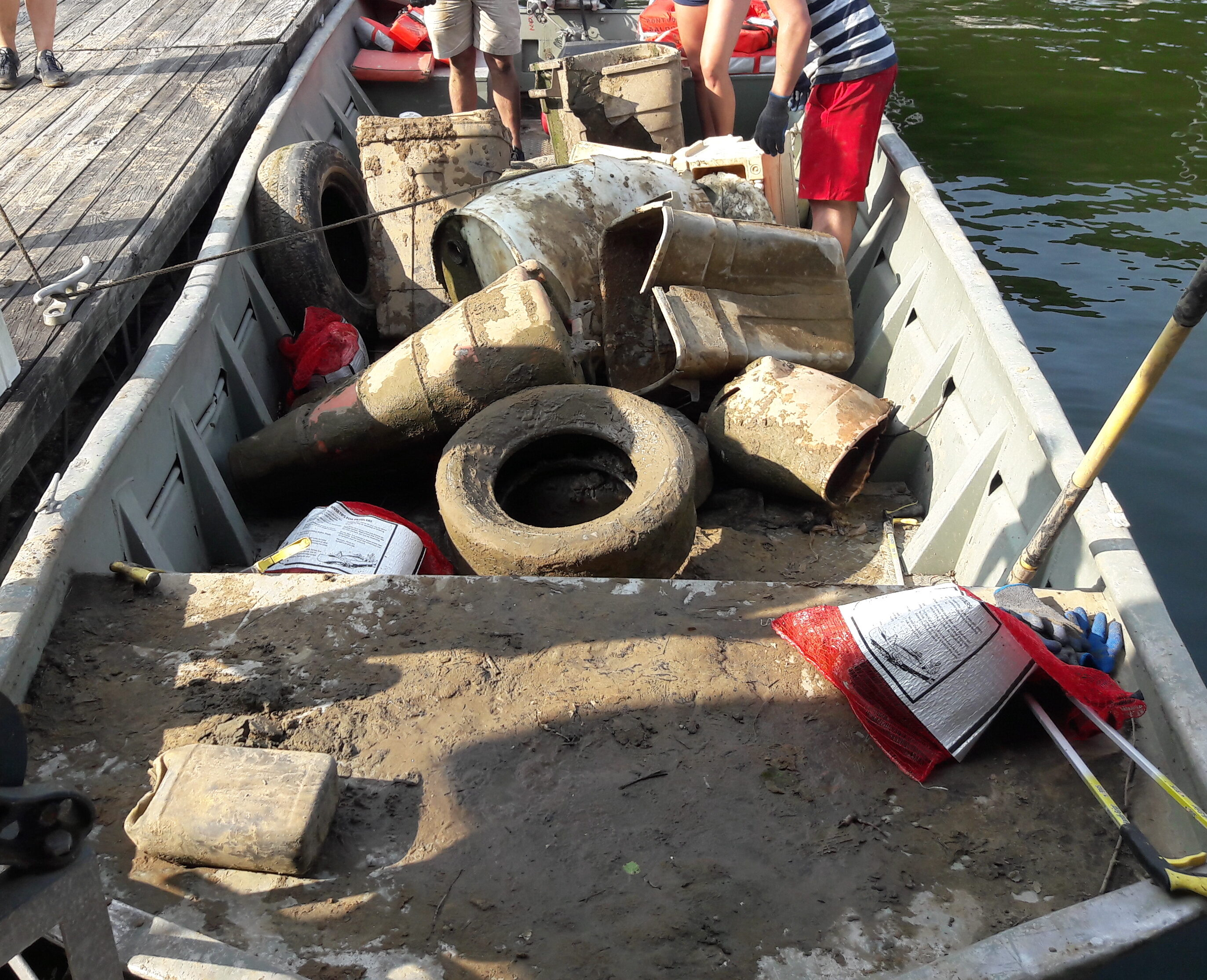 Volunteers are unloading the boat at the dock