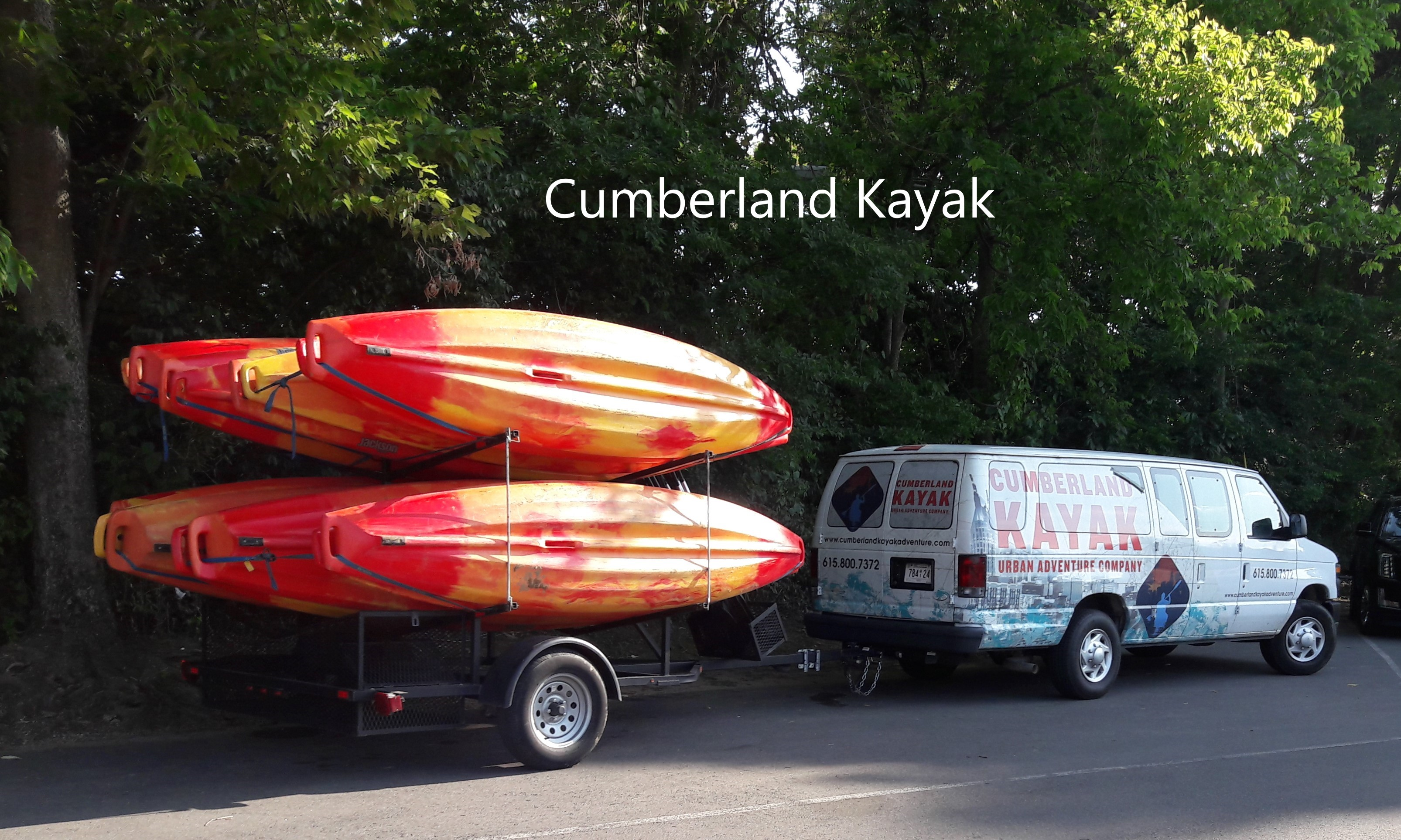 passenger van and kayaks parked in the shade