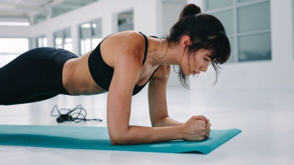 women performing a plank exercise