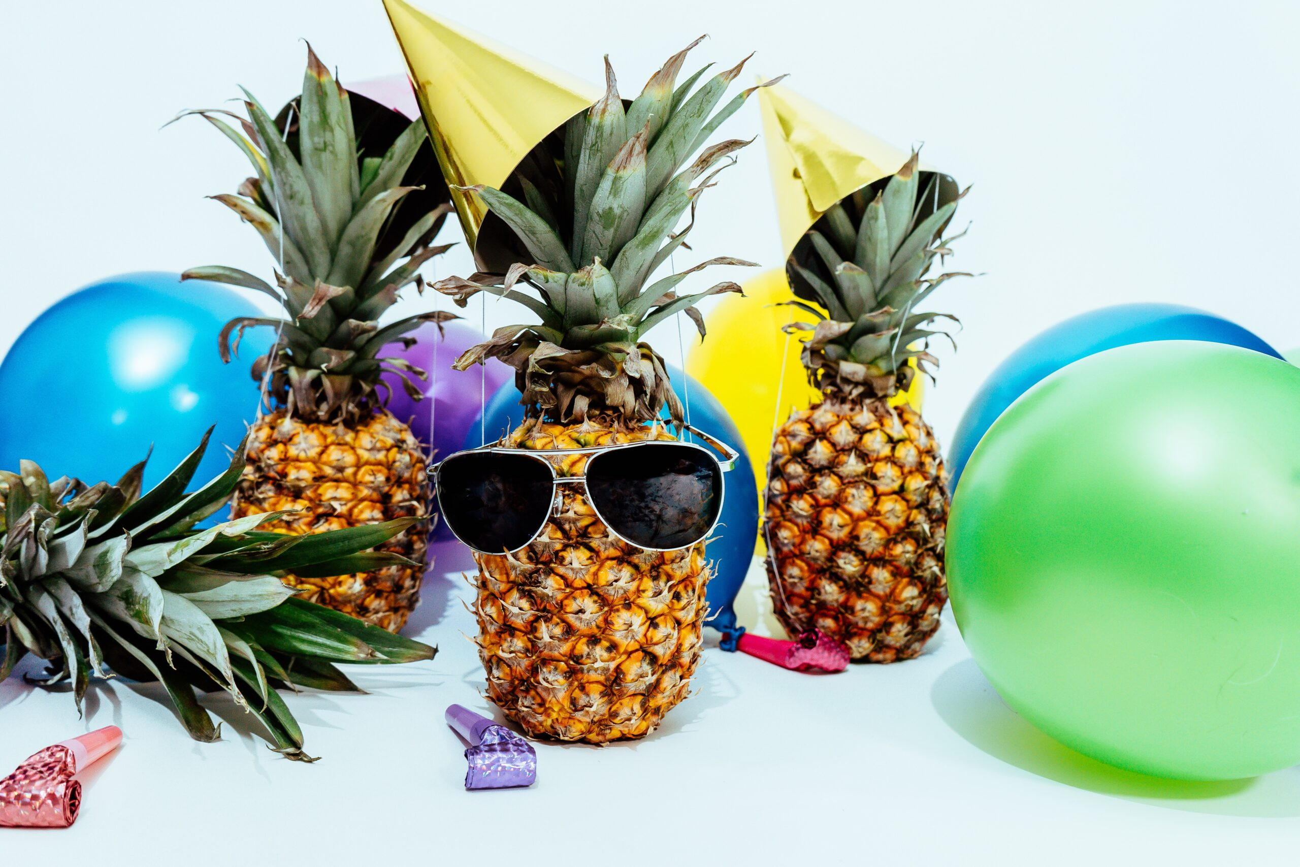 photo-of-three-pineapples-surrounded-by-balloons-1071882