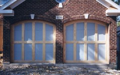 Unfinished dual garage doors - with arch and not windows