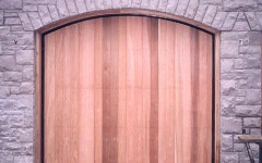Single arched residential overhead door without windows