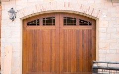 Mohagany arched residential overhead door with windows