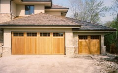 Dual custom garage door with windows and utility garage