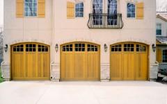 Triple garage door with arch and windows blonde