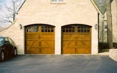 Dual single overhead garage doors with windows and arches 6