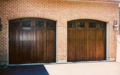Dual single overhead garage doors with windows dark wood