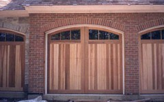 Triple arch residential garage door set