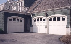 Triple single residential garage doors white with arches