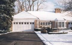 Single overhead residential garage door with windows